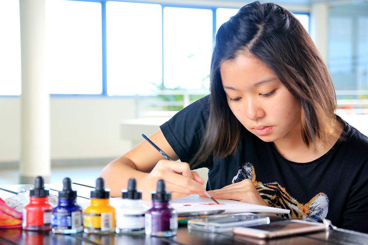 Second-year student Goh, a self-taught painter and artist, enjoys making and selling handmade goods such as phone cases. PHOTO: LU YAWEN