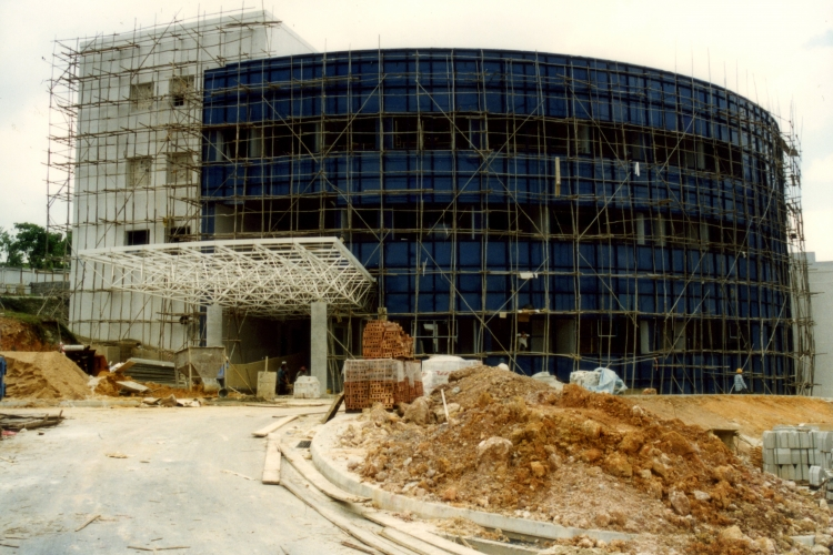 1995: Construction of the School of Communication Studies' new $22.6 million building. Equipped with TV studios, computer laboratories and editing suites, it was vastly different from the school's temporary premises at the Chinese Heritage Centre. When completed, the building was the only one in NTU that was blue and not grey. The school moved into its new premise the following year and the building was officially opened on May 10, 1997 by then Minister for Information and the Arts George Yeo.