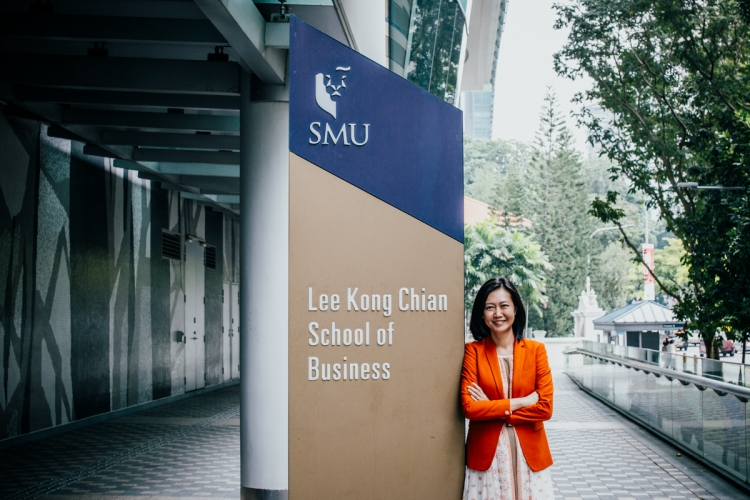 "An assistant professor at SMU's business school, Yeo teaches corporate communications to her students, whom she sees as her ""sons and daughters."" PHOTO: JERLIN HUANG"