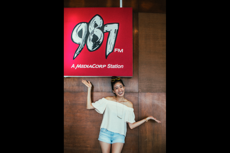 This is Kimberly Wang's fifth year in radio. She hosts two radio programmes at 987FM and comes in to the studio at least six times a week. PHOTO: JERLIN HUANG