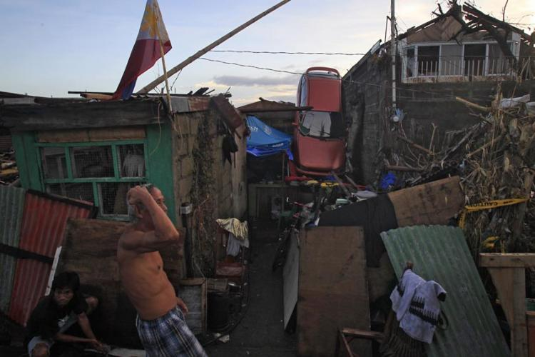 Locals tried to make sense of the aftermath after Typhoon Haiyan caused a massive devastation back in the Philippines in 2013. PHOTO COURTESY OF KEVIN LIM/ The Straits Times